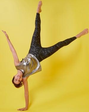 Zoe Williams balances on one hand