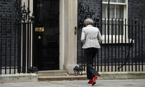 The prime minister, Theresa May, enters No 10 Downing Street
