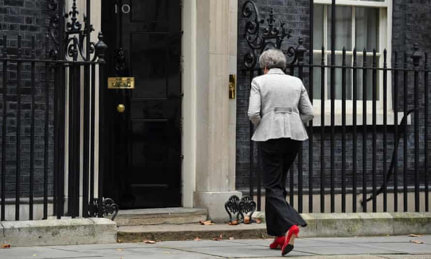 Theresa May enters 10 Downing Street.