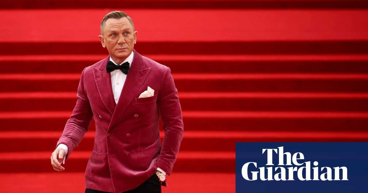 'It's time we embraced a pink blushing Bond': 007's cerise suit jacket is symbolic of his evolving style