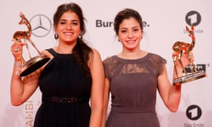 Sara and Yusra Mardini with trophies at the 2016 Bambi awards, the main German media awards.