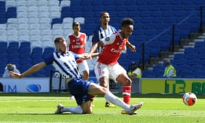 Arsenal's Pierre-Emerick Aubameyang is thwarted by Brighton & Hove Albion's Adam Webster.