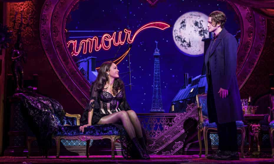Aaron Tveit, right, appears with Karen Olivo during a performance of Moulin Rouge! The Musical