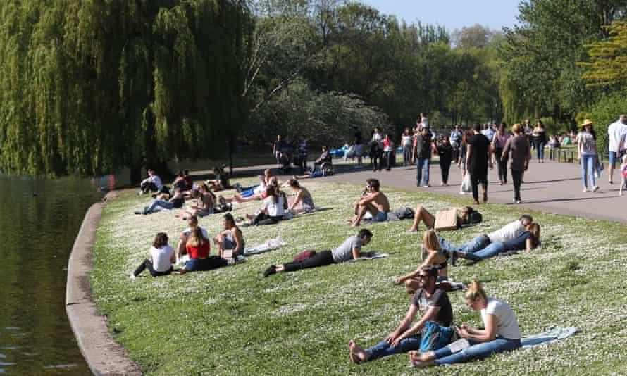 People enjoy the sun in Regent's Park, London