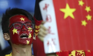 A Chinese fan cheers during the Group A World Cup 2018 qualifier against Qatar in Kunming