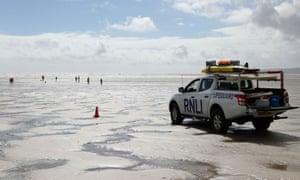 RNLI lifeguard vehicle patrolling at Camber Sands