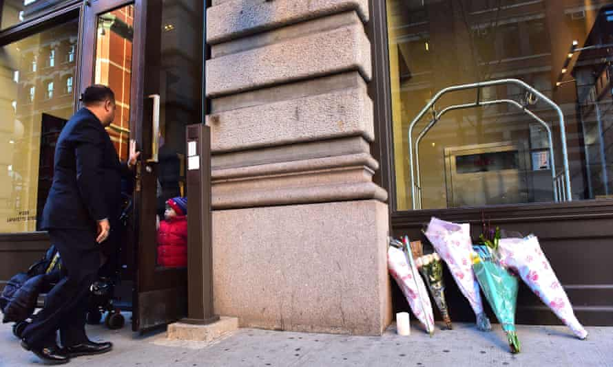Flowers are laid at the entrance to Bowie's apartment building in Soho, New York.