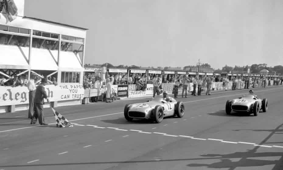 Moss and Fangio crossing the line virtually together.