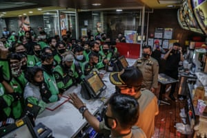 Bogor, Indonesia. Delivery drivers queue up at a McDonald's outlet to buy the new BTS meal, inspired by the K-pop group Bangtan Boys. The queues in the K-pop mad country have resulted in more than a dozen McDonald's to temporarily shut over fears of spreading coronavirus