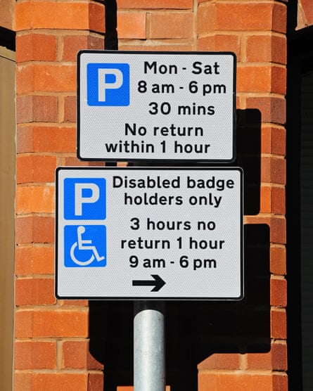 Parking restrictions signs showing the times for both abled and disabled drivers