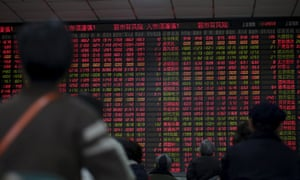 Stock information at a brokerage house in Shanghai: markets on Friday were volatile after Beijing ditched a circuit breaker that halted trading twice this week.