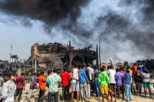 Lagos, NigeriaPeople gather at the scene of a gas explosion which killed at least 15 people, injured many more and destroyed around 50 buildings.