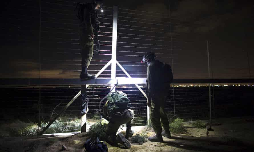 Israeli soldiers repair a malfunction in Israel's border fence with Gaza.