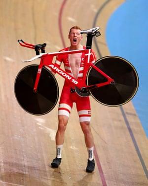 Denmark's Frederik Madsen celebrates winning gold in the men's team pursuit.