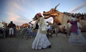 Burning Man revelers dance at sunrise. The 10-day desert festival is turning 30 this year, but a lot has changed since is started on a beach in San Francisco.