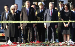 President Erdoğan (second left) at a wreath-laying ceremony at the site of the Ankara bombings.