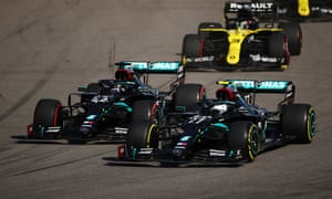 Valtteri Bottas challenges Lewis Hamilton for the lead going into the first corner at Sochi.