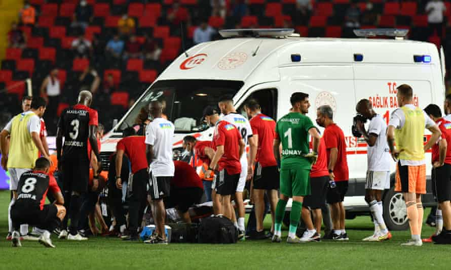 An ambulance crew attend to Fabrice Nsakala after the Besiktas defender collapsed on the pitch.