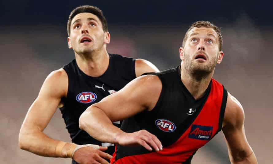 Tom Bellchambers of the Bombers and Marc Pittonet of the Blues
