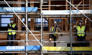 Construction workers at the Kainga Ora housing development in Auckland. New Zealand suffers a chronic lack of housing stock, critics say.