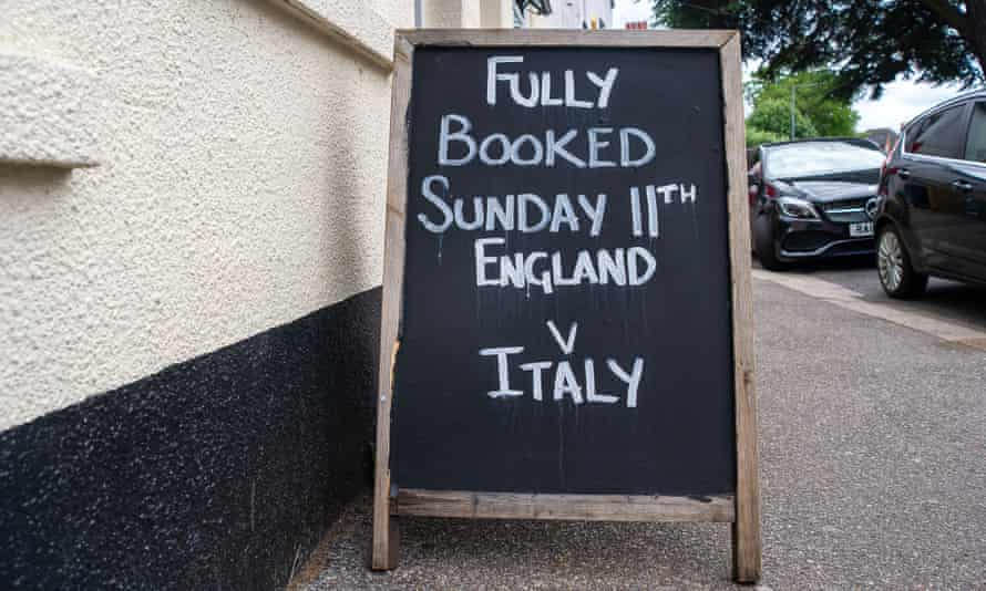 A packed sign outside a pub.