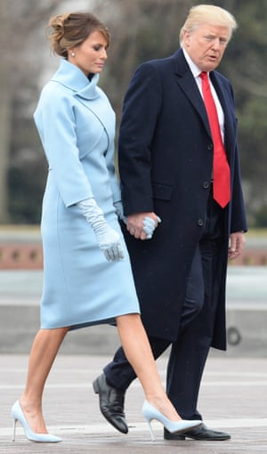 The president and the first lady walk hand-in-hand after Trump's swearing-in.