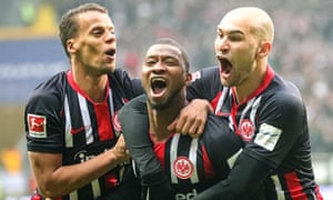 Eintracht Frankfurt's Almamy Toure (centre) celebrates with teammate Timothy Chandler (left) and Bas Dost after scoring against RB Leipzig.