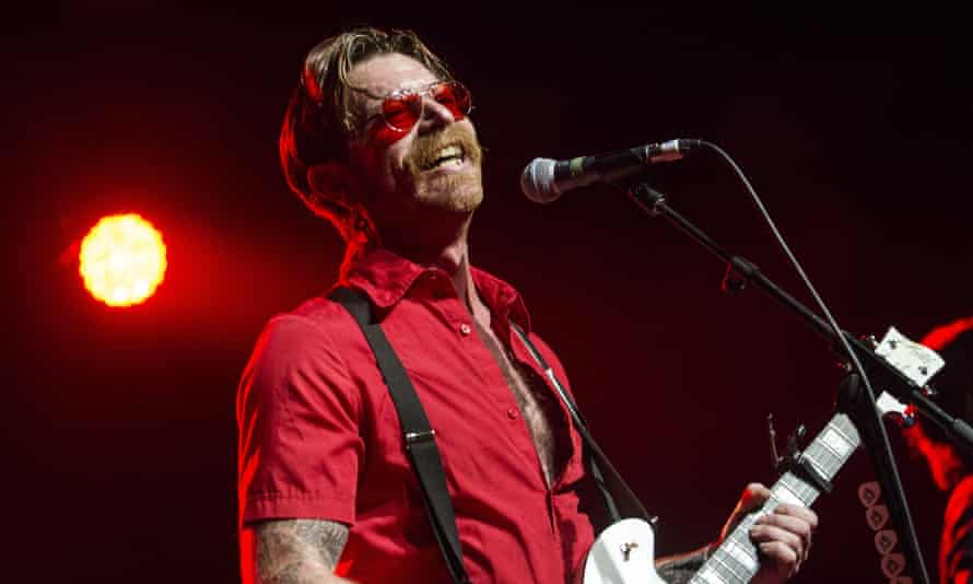 Hughes performing with Eagles of Death Metal in Glasgow, August 2016.