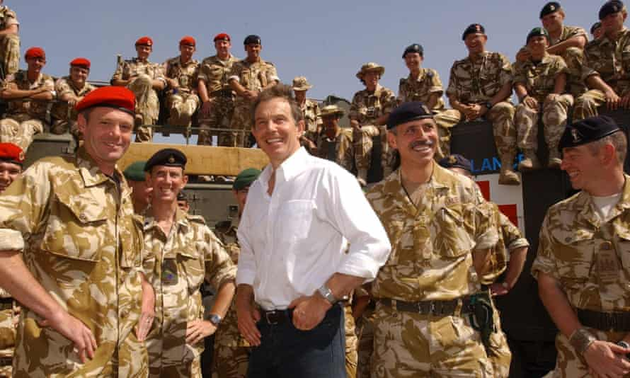 Tony Blair meets British troops in Iraq in 2003. He now 'cuts a lonely and wretched figure'.