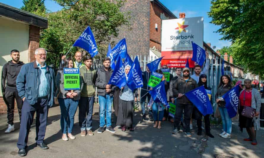 Teachers protest outside Starbank school in South Yardley, Birmingham, on Thursday.