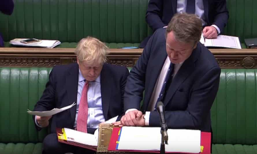 Alister Jack is seen next to Boris Johnson at PMQs on 28 March 2020.