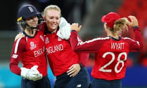 Sarah Glenn celebrates with Amy Jones and Danielle Wyatt after claiming a wicket against West Indies