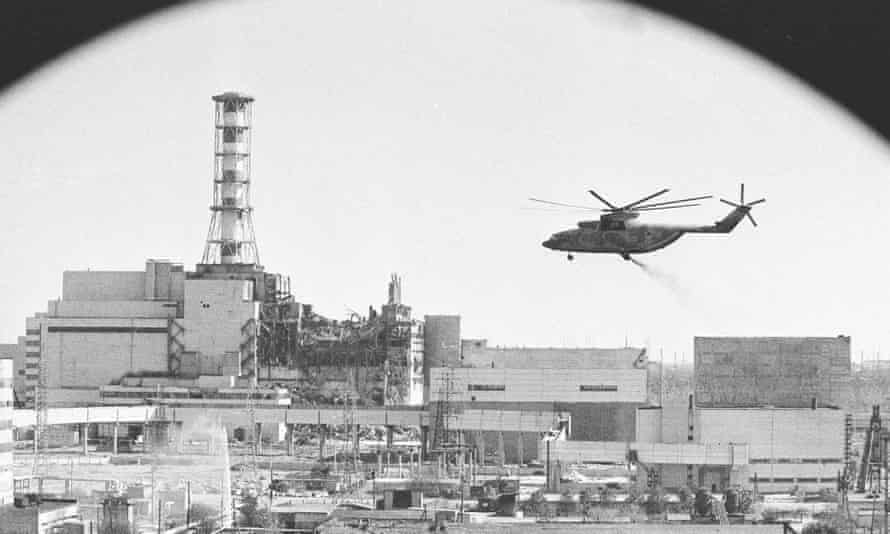 A helicopter on a run to  drop material into the opening in the roof of the damaged Chernobyl reactor, 1986. Photograph: Igor Kostin, Sputnik Images