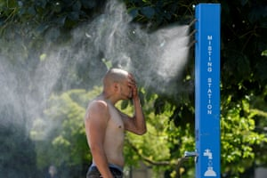 Vancouver, Canada: A man cools off at a misting station during the scorching weather.