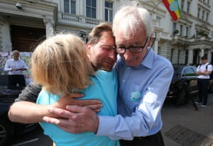 Richard Ratcliffe's parents embrace him outside the Iranian embassy in London after he and his wife ended their hunger strikes.