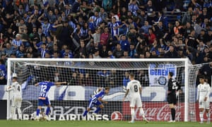 Manu García (centre), sends the Alavés supporters into delirium after rising above Real Madrid's Sergio Ramos (left) to score a late winner.