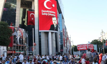 Pro-Erdogan supporters gather during a rally against the military coup at Kizilay Square in Ankara, on 25 July