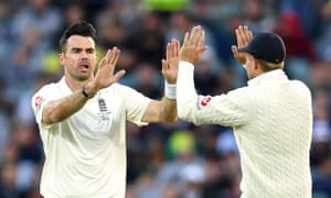 Jimmy Anderson and Joe Root react to the wicket of Cameron Bancroft.