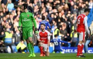 Petr Cech and Shkodran Mustafi react after conceding Hazard's goal.