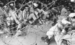 Egyptian prisoners captured by Israeli forces on the west bank of the Suez canal, October 1973.