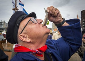Scheveningen, The NetherlandsA visitor swallows a fish during Vlaggetjesdag (Flagday), the day on which traditionally the new herring is shipped into the harbour