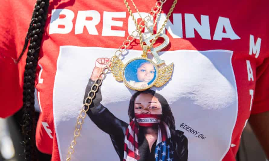 A cousin of Breonna Taylor marches during a National Mother's March in St Paul, Minnesota, on 12 July.