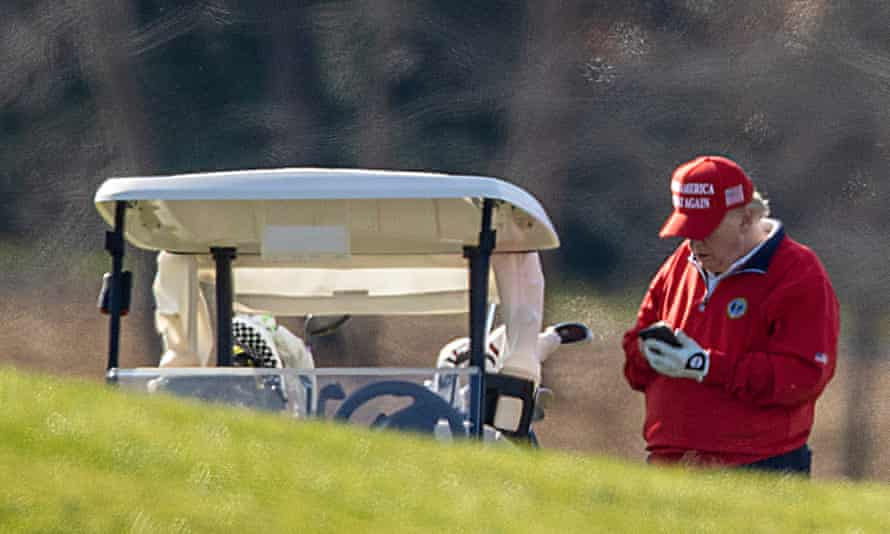 Donald Trump uses his mobile phone while on his golf course in Sterling, Virginia.