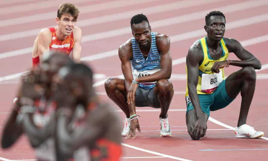 Peter Bol (right) fails to find solace from the scoreboard at Tokyo Olympic Stadium after being overhauled by Emmanuel Korir and Ferguson Rotich (bottom left) and Poland's Patryk Dobek.