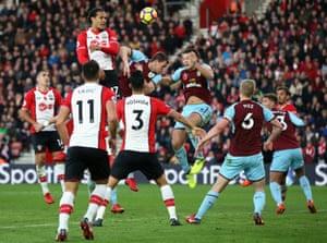 Virgil van Dijk of Southampton beats Burnley players to a header as Burnley win 1-0 away at at St Mary's Stadium.