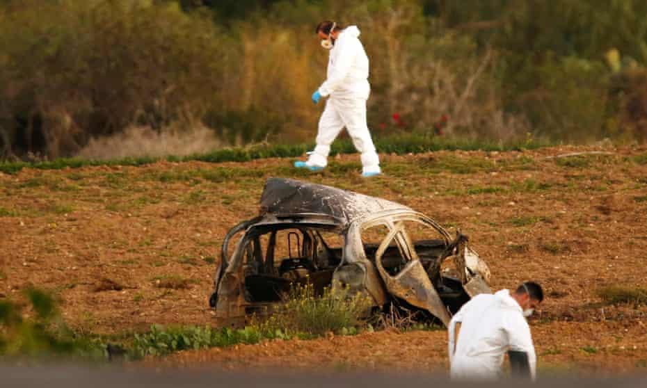 Investigators at the scene of Daphne Caruana Galizia's murder.