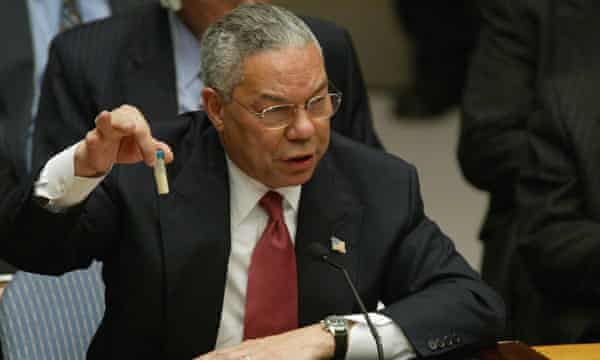 Colin Powell holds up a vial that could contain anthrax during his address to the UN security council, 5 February 2003.