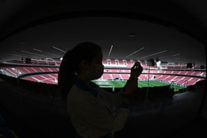 A paramedic prepares a dose of the vaccine at Wanda Metropolitano Stadium in Madrid.