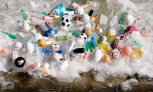 Plastic bottles, footballs and other litter gathered by the currents in the river Tiber in Rome.