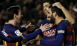 Barcelona's Arda Turan enjoys his goal with team-mates Lionel Messi and Luis Suarez.